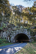 Lickstone Ridge Tunnel (406-feet long, elevation 5150 ft) is at Milepost 458.8 of the Blue Ridge Parkway in the Blue Ridge Mountains (a subset of the Appalachian Mountains), North Carolina, USA. A lickstone was a smooth stone where settlers would spread salt for their livestock. South of Soco Gap, the Parkway traverses the Eastern Cherokee Reservation and ends in the town of Cherokee. The scenic 469-mile Blue Ridge Parkway was built 1935-1987 to aesthetically connect Shenandoah National Park (in Virginia) with Great Smoky Mountains National Park in North Carolina, following crestlines and the Appalachian Trail.