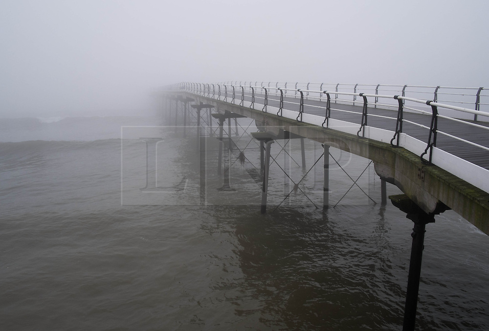 &copy; Licensed to London News Pictures. 04/04/2014<br /> <br /> Saltburn by the Sea, United Kingdom<br /> <br /> Heavy fog shrouds the Victorian pier in Saltburn by the Sea in Cleveland.<br /> <br /> Photo credit : Ian Forsyth/LNP