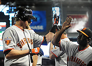 Apr. 17 2011; Phoenix, AZ, USA; San Francisco Giants batter Aubrey Huff (17) is congratulated by teammates after hitting a home run during the fourth inning against the Arizona Diamondbacks at Chase Field. Mandatory Credit: Jennifer Stewart-US PRESSWIRE..