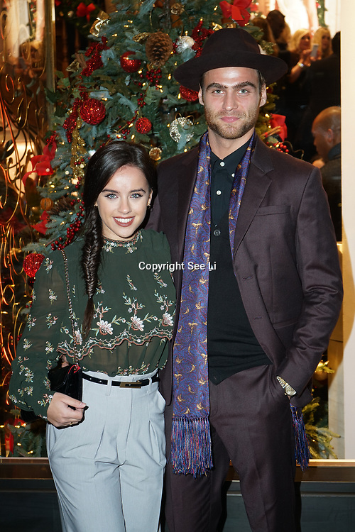 Georgia May Foote and guest attends the Aspinal of London store on Regent's Street St. James's on December 5, 2017 in London, England.