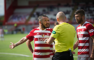 12th August 2017, SuperSeal Stadium, Hamilton, Scotland; SL Football league Hamilton Academicals versus Dundee; Hamilton's Dougie Imrie rages at referee Bobby Madden after the official had awarded Dundee a penalty
