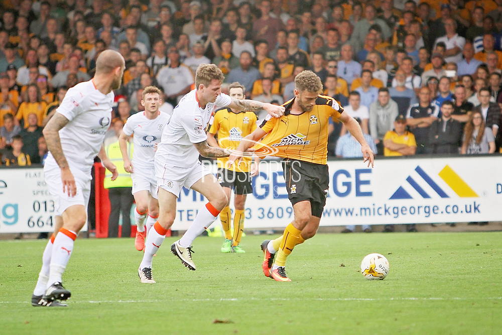 Cambridge Utd forward Ben Williamson (10) has his shirt pulled during the EFL Sky Bet League 2 match between Cambridge United and Luton Town at the R Costings Abbey Stadium, Cambridge, England on 27 August 2016. Photo by Nigel Cole.