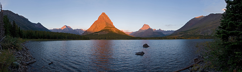 Sunrise on Grinnell Point across Swiftcurrent Lake, Glacier National Park