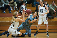South Burlington's Liz Sargent (14) and Burlington's Riley Janeway (31) battle for the loose ball during the girls basketball game between the South Burlington Rebels and the Burlington Sea Horses at Burlington High School on Tuesday night Febraury 2, 2016 in Burlington. (BRIAN JENKINS/for the FREE PRESS)