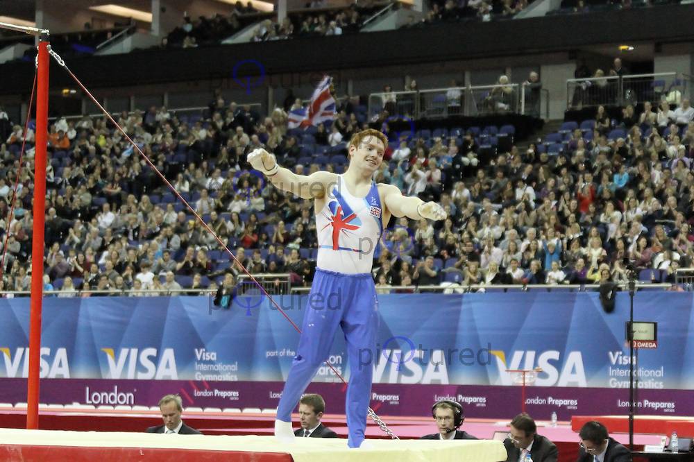 LONDON - JANUARY 13:  Great Britain's Daniel Purvis performs on the Horizontal Bar, Visa International Artistic Gymnastics - London 2012 Olympics Test Event at the North Greenwich Arena, London, UK on January 13, 2012. (Photo by Richard Goldschmidt)