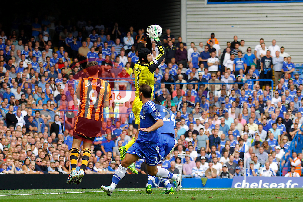 Chelsea's Petr Cech catches the ball in front of Hull City's Danny Graham  - Photo mandatory by-line: Mitchell Gunn/JMP - Tel: Mobile: 07966 386802 18/08/2013 - SPORT - FOOTBALL - Stamford Bridge - London -  Chelsea v Hull City - Barclays Premier League