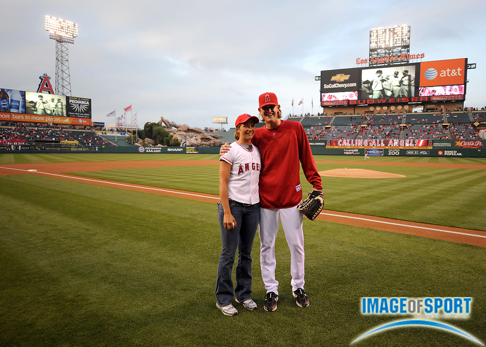 Apr 30, 2007; Anaheim, CA, USA;  Misty May-Treanor poses with Los Angeles pitcher Jered Weaver at Angel Stadium. Mandatory Credit: Kirby Lee/Image of Sport-US PRESSWIRE