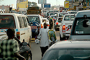 Street sellers sell goods to passing customers stuck in Kampala's traffic. Kampala, Uganda, Africa.