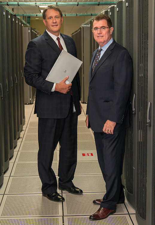 Houston ISD Chief Technology Officer Lenny Schad, left, and Superintendent Dr. Terry Grier, right, pose for a photograph in the HISD Data Center, September 4, 2013.