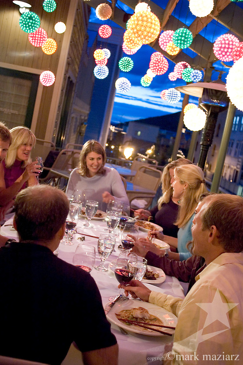Group dining on deck at Wahso above Main Street, Park City, Utah