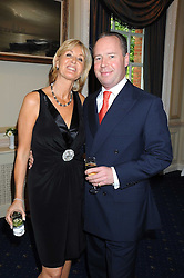 SUZY PARSONS and her husband JAMIE BUCHANAN at a party to celebrate the publication on 'Unsuitable' by Suzy Parsons held at St.Stephen's Club, 34 Queen Anne's Gate, London SW1 on 19th June 2008<br />