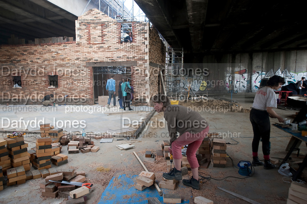 finishing construction FOLLY FOR A FLYOVER conceived and built by Assemble. Winner of the Bank of America Merrill Lynch award 2011. Hackney Wick. London. 23 June 2011. <br /> <br />  , -DO NOT ARCHIVE-© Copyright Photograph by Dafydd Jones. 248 Clapham Rd. London SW9 0PZ. Tel 0207 820 0771. www.dafjones.com.