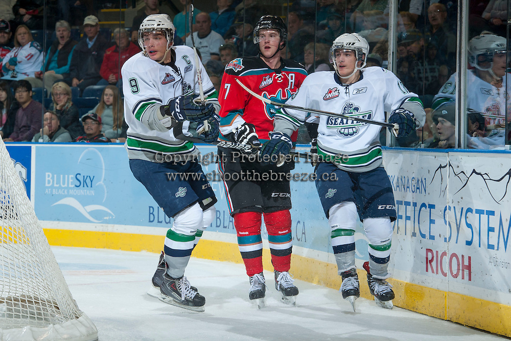 KELOWNA, CANADA - OCTOBER 11:   Justin Hickman #9 and Mathew Barzal #13 of the Seattle Thunderbirds and Damon Severson #7 of the Kelowna Rockets stand at the boards  on October 11, 2013 at Prospera Place in Kelowna, British Columbia, Canada (Photo by Marissa Baecker/Shoot the Breeze) *** Local Caption ***
