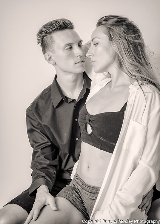 Young couple in love. Black and white photograph captured by professional photographer Barry A Mosley, who is located in Lincoln, NE.