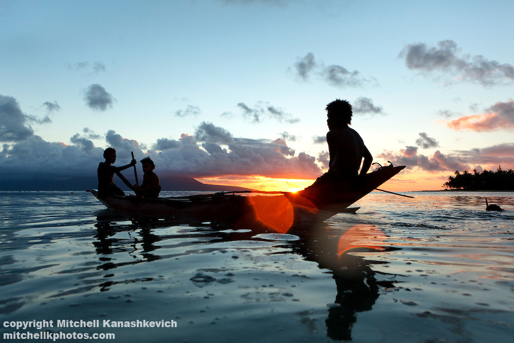 Ni Vanuatu boys sit in an outrigger canoe in the lagoon which separates Rah from Mota Lava Island, Banks Island group, Torba Province, Vanuatu