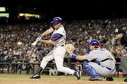 Phoenix, AZ-04-28-04 Arizona Diamondbacks center fielder Steve Finley hits his 2nd of 3 solo home runs of the night in a 4-3 loss to the Chicago Cubs. Ross Mason photo