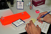 labelling sample slides to viewe under an optical microscope. Photographed at the University of Haifa