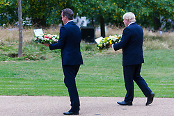 Hyde Park, London, July7th 2015. The Mayor of London Boris Johnson and other senior political figures, the Commissioners for transport and policing in the capital, as well as senior representatives of the emergency services  lay wreaths at the 7/7 memorial in Hyde Park. PICTURED: Prime Minister David Cameron and Mayor of London Boris Johnson prepare to lay their wreaths.