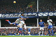Everton striker Theo Walcott (11) and Cardiff City defender Greg Cunningham (18) challenge for the high ball during the Premier League match between Everton and Cardiff City at Goodison Park, Liverpool, England on 24 November 2018.