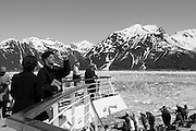 Alaska, USA, touring boat near a glacier. In black and white