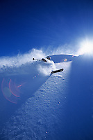 A skier makes turns through deep snow in the backcountry of Jackson Hole, Wyoming.