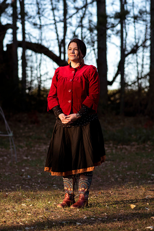 """Beth Waukechon, 37, who grew up with ties to both the reservation and the german culture of her mother's side of the family, felt more pulled towards the Menominee traditions. """"There's a sense you get when you cross the reservation line, and I don't know how to explain it, completely. Like I'm allowed to breathe."""" The Menominee in northern Wisconsin are preparing for the ways in which climate change could affect their forest in the future, in which invasive species could impact the life cycle of trees in the area. 95 percent of the land is occupied by trees here, and the forest is so dense that the reservation's sharp outline is visible from space. The land owned by the neighboring community of Shawano County is recognizable by the sudden and stark division of forest and open fields. <br /> <br /> <br /> Photo by Lauren Justice"""