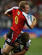 Jano Vermaak is tackled during the Super Rugby (Super 15) fixture between the DHL Stormers and the Lions held at DHL Newlands Stadium in Cape Town, South Africa on 26 February 2011. Photo by Jacques Rossouw/SPORTZPICS