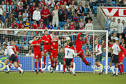 OSLO, NORWAY - Thursday, May 27, 2004:  Wales' Chris Llewelyn, Robert Edwards, Gareth Roberts and Carl Fletcher defend a free-kick from Norway's Martin Andresen during the International Friendly match at the Ullevaal Stadium, Oslo, Norway. (Photo by David Rawcliffe/Propaganda)