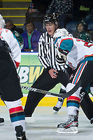 KELOWNA, CANADA - DECEMBER 30:  Ward Pateman, linesman, prepares to drop the puck as the Everett Silvertips play the Kelowna Rockets on December 30, 2012 at Prospera Place in Kelowna, British Columbia, Canada (Photo by Marissa Baecker/Shoot the Breeze) *** Local Caption ***