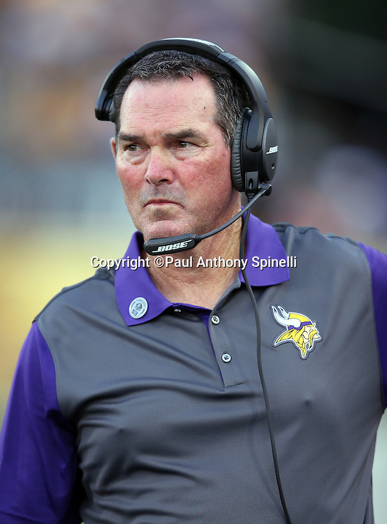 Minnesota Vikings head coach Mike Zimmer looks on from the sideline during the 2015 NFL Pro Football Hall of Fame preseason football game against the Pittsburgh Steelers on Sunday, Aug. 9, 2015 in Canton, Ohio. The Vikings won the game 14-3. (©Paul Anthony Spinelli)