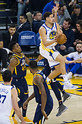 Golden State Warriors guard Klay Thompson (11) takes teh ball to the basket against the Utah Jazz at Oracle Arena in Oakland, Calif., on December 27, 2017. (Stan Olszewski/Special to S.F. Examiner)