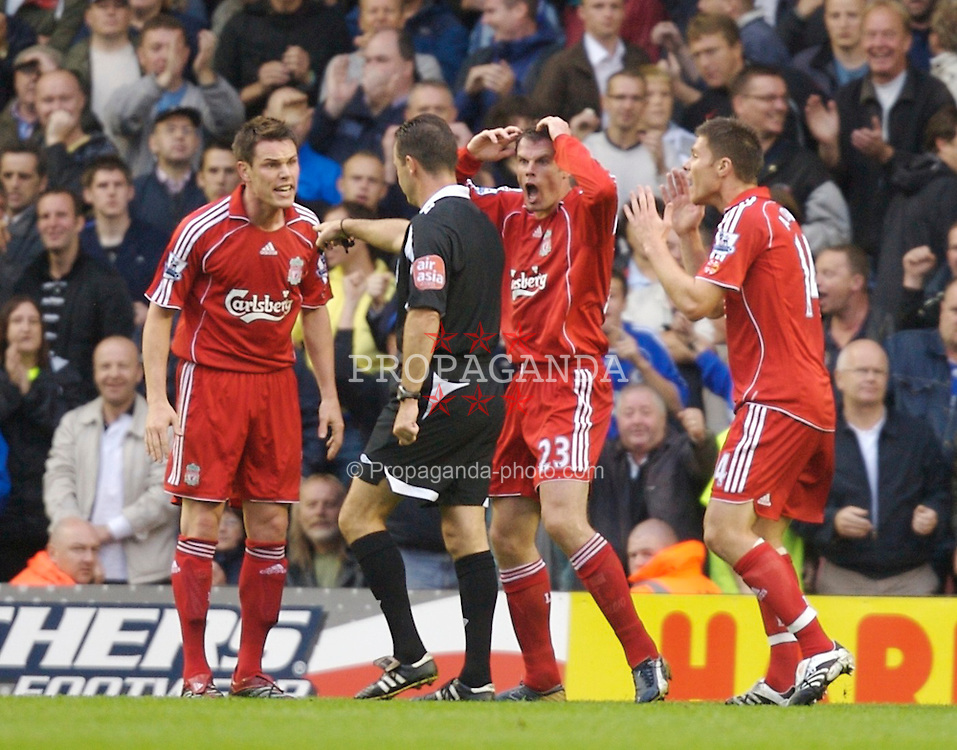 Liverpool, England - Sunday, August 19, 2007: Liverpool's Jamie Carragher can hardly believe his eyes as referee Rob Styles mysteriously awards a penalty to Chelsea, who were 1-0 down at the time, despite no foul being committed during the Premiership match at Anfield. (Photo by David Rawcliffe/Propaganda)