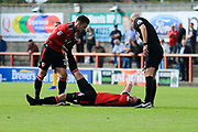 Alex Kenyon of Morecambe goes down with cramp during the EFL Sky Bet League 2 match between Morecambe and Newport County at the Globe Arena, Morecambe, England on 16 September 2017. Photo by Mick Haynes.