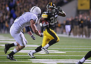 October 2 2010: Iowa Hawkeyes running back Adam Robinson (32) tries to get around Penn State Nittany Lions safety Nick Sukay (1) during the first half of the NCAA football game between the Penn State Nittany Lions and the Iowa Hawkeyes at Kinnick Stadium in Iowa City, Iowa on Saturday October 2, 2010. Iowa defeated Penn State 24-3.