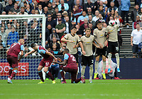 Football - 2019 / 2020 Premier League - West Ham United vs. Manchester United<br /> <br /> Aaron Cresswell of West ham scores goal no 2 from a free kick, at The London Stadium.<br /> <br /> COLORSPORT/ANDREW COWIE