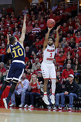 15 March 2017:  Luke Nelson stands too far off to block the shot by Keyshawn Evans(3) during a College NIT (National Invitational Tournament) mens basketball game between the UC Irvine Anteaters and Illinois State Redbirds in  Redbird Arena, Normal IL