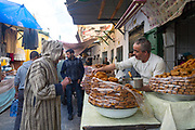 Moroccan chebekia and birouat street food stall, Tetouan, Rif region of Northern Morocco, 2016-04-05. <br />