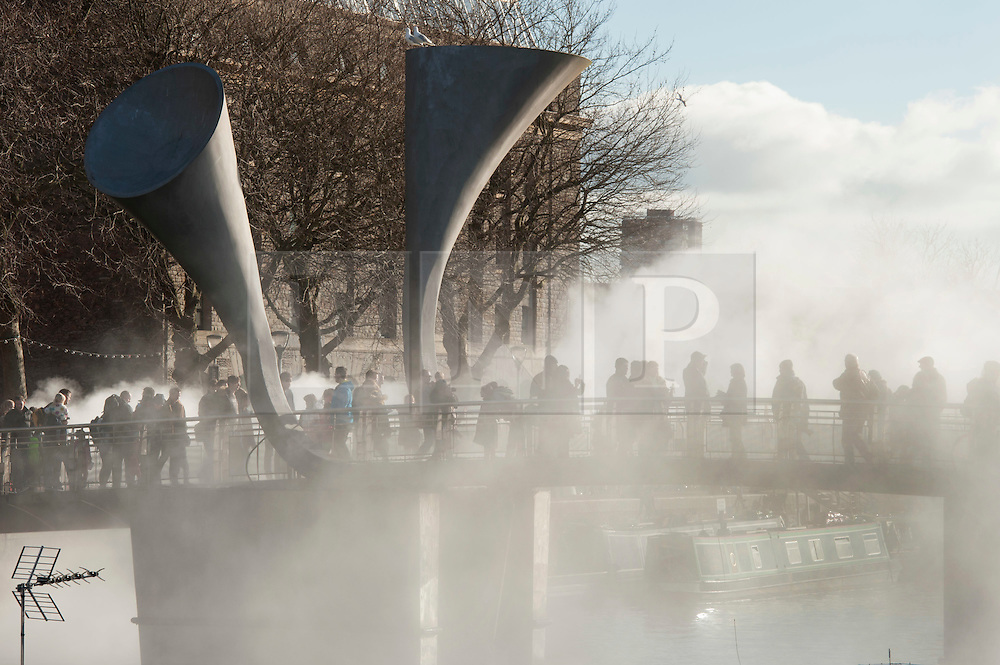 "© Licensed to London News Pictures.  14/02/2015. Bristol, UK.  Pero's bridge in Bristol docks disappears in a veil of fog as part of IBT/15 (In Between Time) arts festival.<br /> To celebrate Bristol's status as European Green Capital for 2015, IBT/15 invited a conjurer of unusual weather, artist Fujiko Nakaya to the city.  Over 40 years, Nakaya has used fog as a sculptural medium. Collaborating with the elements, Fujiko's clouds are created by water pumped at high pressure through many micro-fine nozzles.  ""The world is getting warmer – but how will this change our weather? And how might a changing climate disrupt our lives?""  Pero's bridge is named after an African slave who lived in Bristol.  Photo credit : Simon Chapman/LNP"
