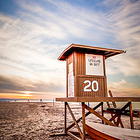Lifeguard Tower 20 Newport Beach CA a sunrise picture. Lifeguard Tower #20 is located at 20th Street on Balboa Peninsula along the Pacific Ocean in Orange County Southern California.