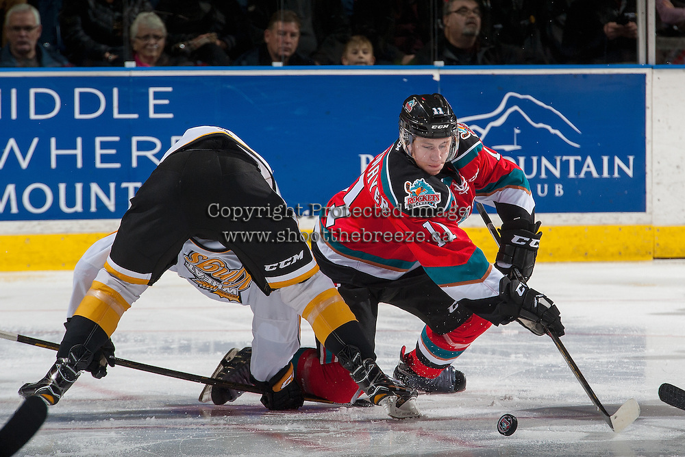 KELOWNA, CANADA - DECEMBER 3: Jordan Borstmayer #11 of the Kelowna Rockets digs for the puck after the face off against the Brandon Wheat Kings during second period on December 3, 2016 at Prospera Place in Kelowna, British Columbia, Canada.  (Photo by Marissa Baecker/Shoot the Breeze)  *** Local Caption ***