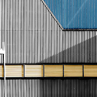 A striking and corrugated metal facade with two ventilation grilles.