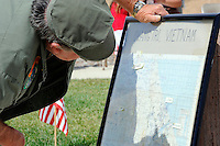 A veteran reads a map of Vietnam at Monday's somber Memorial Day remembrances at the Monterey County Vietnam Veterans Memorial in Salinas.
