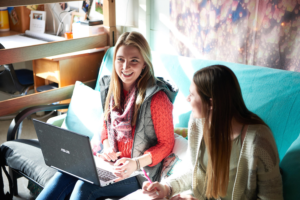 Activity; Socializing; Talking; Smiling; Buildings; Laux Hall; Dorm; Location; Inside; Objects; Chair; Bed; Books; Desk; Phone Cell Smartphone iPhone; Computer; People; Student Students; Woman Women; Type of Photography; Candid; UWL UW-L UW-La Crosse University of Wisconsin-La Crosse; Winter; January; Time/Weather; day