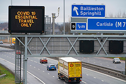 Glasgow, Scotland, UK. 26 March, 2020.Variable message sign on M8 Motorway in Glasgow instructing drivers that only essential travel is permitted during the Covid-19 lockdown in the UK. Iain Masterton/Alamy Live News