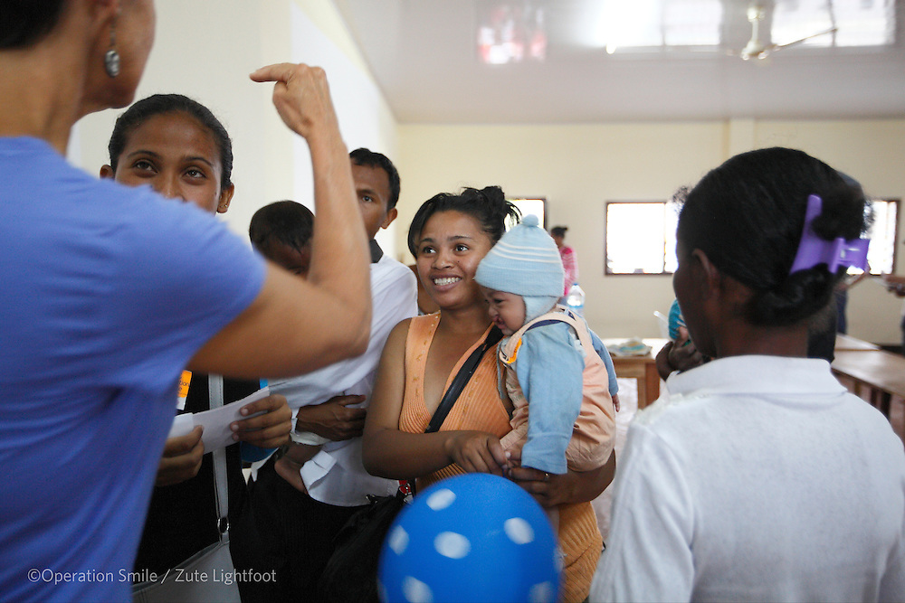 Mother of 064, Miratriniana FinaritraRamiarisoa, male, 11 months old hears that they are on the surgery schedule on patient announcement day. Operations Smile's 2015 mission to Tamatave at Tamatave General Hospital. Antsirabe Clinic Project sponsored by the Swedish Postal Code lottery. Madagascar. September 2015.<br /> (Operation Smile Photographer &ndash; Zute Lightfoot)