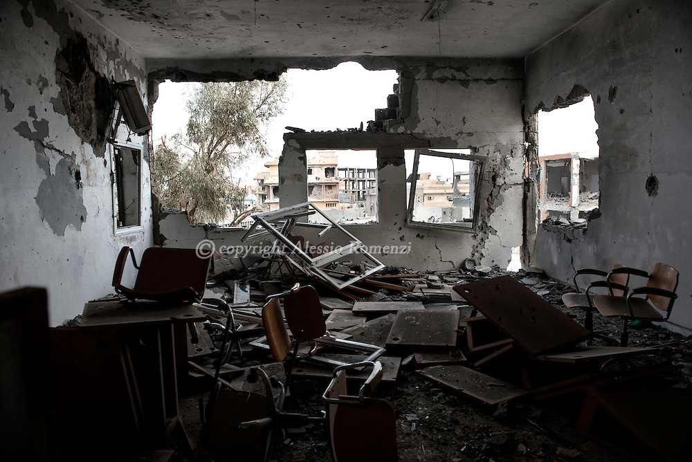 Libya, Sirte: View of the area in Al Jiza neighbourhood under ISIS control through a destroyed building in Sirte on November 24, 2016.  Alessio Romenzi