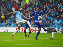 September 22, 2018 - Cardiff City, England, United Kingdom - Ilkay Gundogan of Manchester City and Sean Morrison of Cardiff City challenge for the ball during the Premier League match between Cardiff City and Manchester City at Cardiff City Stadium,  Cardiff, England on 22 Sept 2018. (Credit Image: © Action Foto Sport/NurPhoto/ZUMA Press)