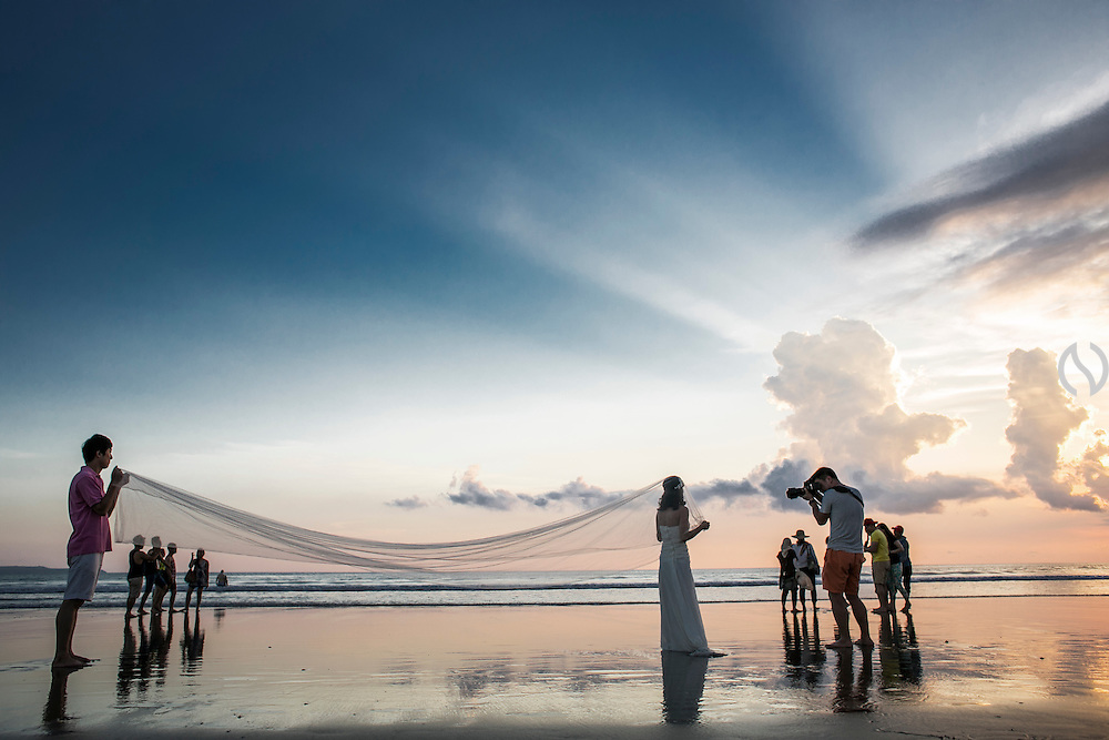 BALI, INDONESIA; MARCH 27, 2015: A pre-wedding photo session at Double Six beach, Bali, Indonesia on Friday, March 27, 2015.