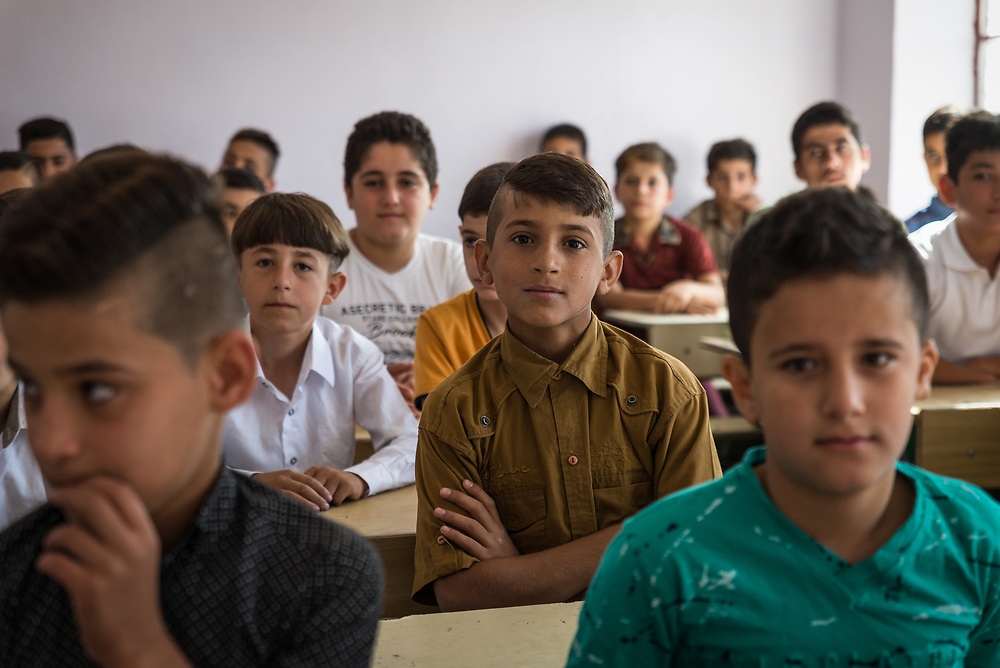 11 October 2017 &ndash; Ninewa Plains &ndash; A class in session at the Al-Taghllubia School for Boys in the Ninewa Plains on the day it reopened after being closed for 3 years. <br /> <br /> UNDP&rsquo;s Funding Facility for Stabilization is helping rehabilitate the school. Miss Fatim, a parent of one of the school&rsquo;s pupils is happy to see her son return to the school. &ldquo;It&rsquo;s very nice to come back to your original place,&rdquo; she said. &ldquo;We appreciate this so much. It&rsquo;s a very nice feeling to see you are here and are helping us, and that students can come back here to study.&rdquo;<br /> <br /> &copy; UNDP Iraq / Claire Thomas