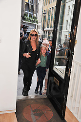KATE MOSS and her daughter LILA GRACE MOSS at a private view of portrait photographs by Debbi Clark in support of the Sir Hubert von Herkomer Arts Foundation, held at The Strand Gallery, 32 John Adam Street, London WC2Non 8th May 2013.